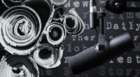 rolled up newspapers and a microphone with titles of podcasts on a black and white background.