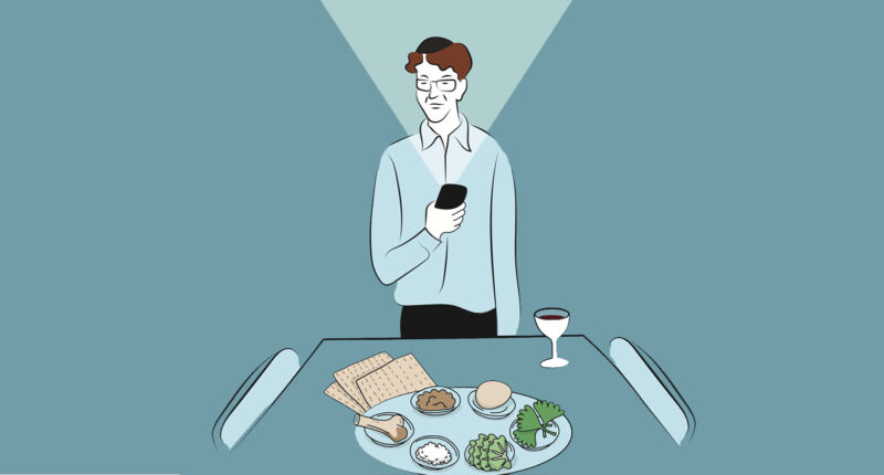 Man looking at the bright screen of a phone looking of a Passover Seder Plate
